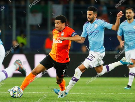 Taison (L) of Shakhtar in action against Riyad Mahrez (R) of Manchester during the UEFA Champions League group C soccer match between Shakhtar Donetsk and Manchester City in Kharkiv, Ukraine, 18 September 2019.