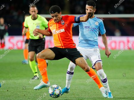 Taison (C) of Shakhtar in action against Riyad Mahrez (R) of Manchester during the UEFA Champions League group C soccer match between Shakhtar Donetsk and Manchester City in Kharkiv, Ukraine, 18 September 2019.