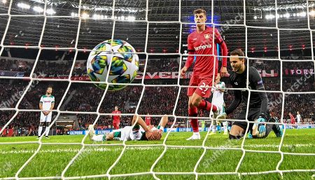 Lokomotiv's Benedikt Hoewedes, reacts on the ground after he's scored an own goal during the Champions League Group D soccer match between Bayer Leverkusen and Lokomotiv Moscow at the BayArena in Leverkusen, Germany