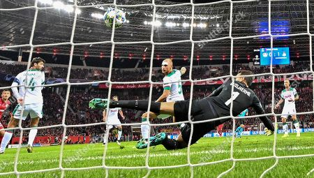 Stock Picture of Lokomotiv's Benedikt Hoewedes scores an own goal against his own keeper Guilherme during the Champions League Group D soccer match between Bayer Leverkusen and Lokomotiv Moscow at the BayArena in Leverkusen, Germany
