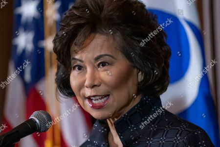 Transportation Secretary Elaine Chao speaks to reporters about President Donald Trump's decision to revoke California's authority to set auto mileage standards stricter than those issued by federal regulators, at EPA headquarters in Washington