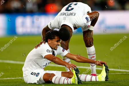 Marquinhos (L) of Paris Saint Germain and Presnel Kimpembe (R) during the UEFA Champions League Group A soccer match between Paris Saint Germain and Real Madrid at the Parc des Princes stadium in Paris, France, 18 September 2019.
