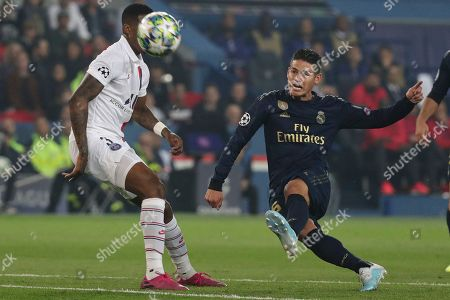Paris Saint Germain's Presnel Kimpembe (L) and Real Madrid's James Rodriguez (R) in action during the UEFA Champions League Group A soccer match between Paris Saint Germain and Real Madrid at the Parc des Princes stadium in Paris, France, 18 September 2019.