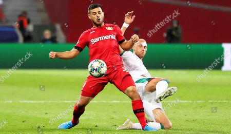 Leverkusen's Kevin Volland (L) in action against Lokomotiv's Benedikt Howedes (R) during the UEFA Champions League group D soccer match between Bayer Leverkusen and Lokomotiv Moscow in Leverkusen, Germany, 18 September 2019.