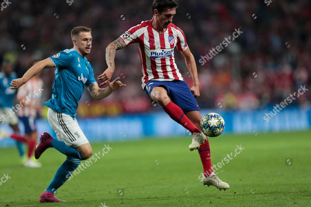 Atletico Madrid's Stefan Savic accepts the ball during the Champions League Group D soccer match between Atletico Madrid and Juventus at the Wanda Metropolitano stadium in Madrid, Spain