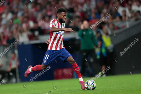 Atletico Madrid's Thomas Lemar runs with the ball during the Champions League Group D soccer match between Atletico Madrid and Juventus at the Wanda Metropolitano stadium in Madrid, Spain