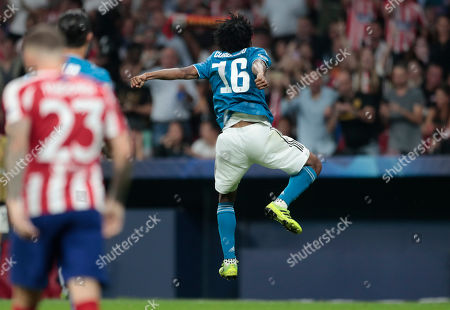 Juventus' Juan Cuadrado celebrates scoring his side's first goal during the Champions League Group D soccer match between Atletico Madrid and Juventus at the Wanda Metropolitano stadium in Madrid, Spain
