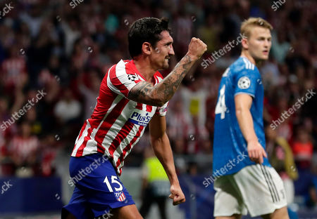 Atletico Madrid's Stefan Savic celebrates scoring his side's first goal during the Champions League Group D soccer match between Atletico Madrid and Juventus at Wanda Metropolitano stadium in Madrid, Spain