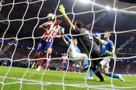 Atletico Madrid's Stefan Savic scores his side's first goal during the Champions League Group D soccer match between Atletico Madrid and Juventus at Wanda Metropolitano stadium in Madrid, Spain