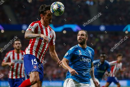 Atletico's defender Stefan Savic (L) in action against Juventus' forward Gonzalo Higuain (R) during the UEFA Champions League group D soccer match between Atletico de Madrid and Juventus at Wanda Metropolitano stadium in Madrid, Spain, 18 September 2019.