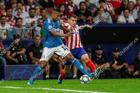 Atletico's forward Angel Correa (R) in action against Juventus' defender Alex Sandro (L) during the UEFA Champions League group D soccer match between Atletico de Madrid and Juventus at Wanda Metropolitano stadium in Madrid, Spain, 18 September 2019.
