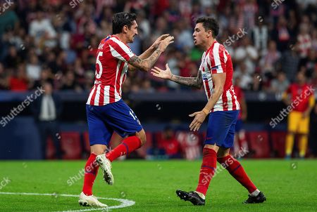 Atletico's defender Stefan Savic celebrates with his teammate Jose Gimenez (R) after scoring the 1-2 goal during the UEFA Champions League group D soccer match between Atletico de Madrid and Juventus at Wanda Metropolitano stadium in Madrid, Spain, 18 September 2019.