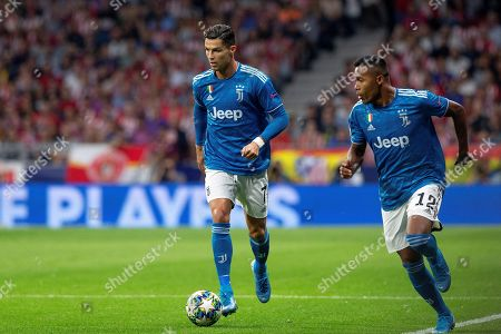 Juventus' forward Cristiano Ronaldo (L) and his teammate Alex Sandro (R) in action during the UEFA Champions League group D soccer match between Atletico de Madrid and Juventus at Wanda Metropolitano stadium in Madrid, Spain, 18 September 2019.