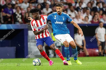 Atletico's midfielder Thomas Partey (L) in action against Juventus' midfielder Sami Khedira (R) during the UEFA Champions League group D soccer match between Atletico de Madrid and Juventus at Wanda Metropolitano stadium in Madrid, Spain, 18 September 2019.