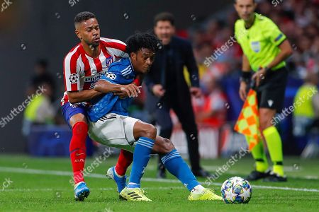 Atletico's defender Renan Lodi (L) in action against Juventus' winger Juan Guillermo Cuadrado (R) during the UEFA Champions League group D soccer match between Atletico de Madrid and Juventus at Wanda Metropolitano stadium in Madrid, Spain, 18 September 2019.