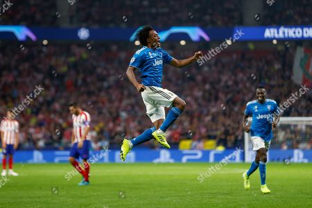 Juventus' winger Juan Guillermo Cuadrado celebrates after scoring the 0-1 goal during the UEFA Champions League group D soccer match between Atletico de Madrid and Juventus at Wanda Metropolitano stadium in Madrid, Spain, 18 September 2019.