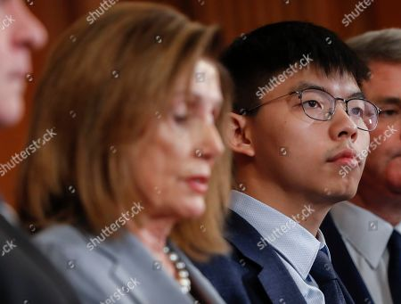 Nancy Pelosi, Joshua Wong. Hong Kong activist Joshua Wong, right, stands with House Speaker Nancy Pelosi of Calif., left and other members of Congress during a news conference on Hong Kong Human Rights on Capitol Hill in Washington