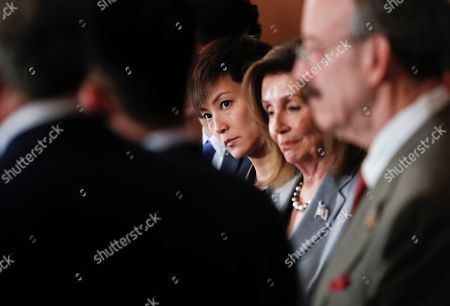 Stock Picture of Nancy Pelosi, Denise Ho. Hong Kong activist Denise Ho, center, stands with House Speaker Nancy Pelosi of Calif., right, and other members of Congress during a news conference on Hong Kong Human Rights on Capitol Hill in Washington