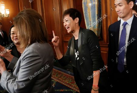 Nancy Pelosi, Denise Ho. Hong Kong activist Denise Ho, center, gestures while speaking with House Speaker Nancy Pelosi, left, following a news conference on Hong Kong Human Rights on Capitol Hill in Washington