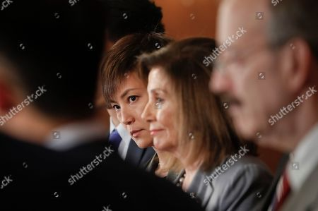 Stock Photo of Nancy Pelosi, Denise Ho. Hong Kong activist Denise Ho, center, stands with House Speaker Nancy Pelosi of Calif., right, and other members of Congress during a news conference on Hong Kong Human Rights on Capitol Hill in Washington