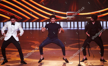 Ayushmann Khurrana, Ishan Khattar, Shahid Kapoor. Bollywood actors Ayushmann Khurrana, left, along with Ishan Khattar, center, and Shahid Kapoor perform during the 20th International Indian Film Academy (IIFA) awards ceremony in Mumbai, India