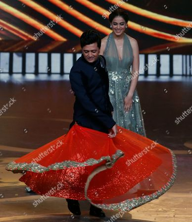 Bollywood actor Ritesh Deshmukh performs during the 20th International Indian Film Academy (IIFA) awards ceremony in Mumbai, India