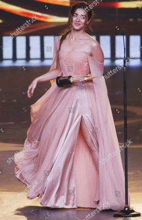 Bollywood actress Alia Bhatt reacts after receiving the best female actor in leading role during the 20th International Indian Film Academy (IIFA) awards ceremony in Mumbai, India