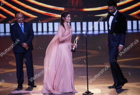 Stock Picture of Bollywood actress Alia Bhatt reacts after receiving the best female actor in leading role during the 20th International Indian Film Academy (IIFA) awards ceremony in Mumbai, India