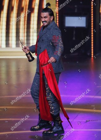 Stock Picture of Bollywood actor Ranveer Singh reacts after receiving the best male actor in leading role during the 20th International Indian Film Academy (IIFA) awards ceremony in Mumbai, India
