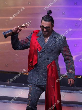 Bollywood actor Ranveer Singh reacts after receiving the best male actor in leading role during the 20th International Indian Film Academy (IIFA) awards ceremony in Mumbai, India