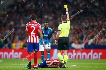 Blaise Matuidi of Juventus receives a yellow card