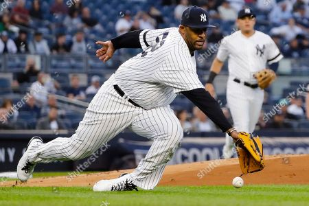 New York Yankees starting pitcher CC Sabathia dives for a ball hit by Los Angeles Angels' David Fletcher during the first inning of a baseball game, in New York. Fletcher was safe at first base