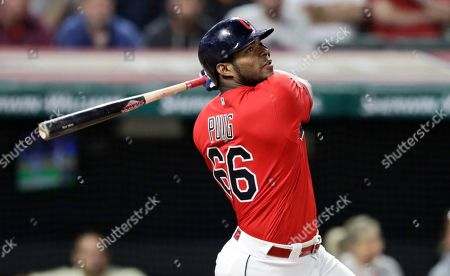 Cleveland Indians' Yasiel Puig watches his ball after hitting a game-winning RBI-single in the 10th inning in a baseball game against the Detroit Tigers, in Cleveland. The Indians won 2-1 in ten innings
