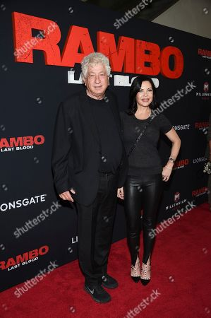 """Stock Image of Avi Lerner, Christa Campbell. Producers Avi Lerner, left, and Christa Campbell attend a special screening of """"Rambo: Last Blood"""" at AMC Lincoln Square, in New York"""