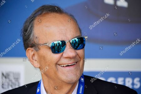 Major League Baseball's chief baseball officer, Joe Torre, speaks to reporters prior to a baseball game between the Los Angeles Dodgers and the Tampa Bay Rays, in Los Angeles