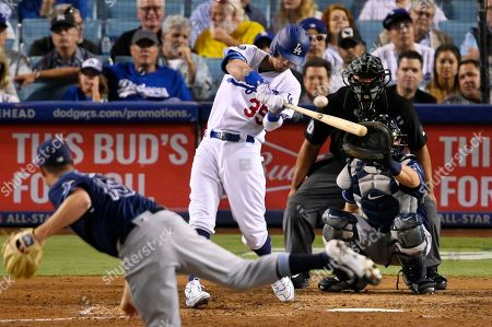 Cody Bellinger, Emilio Pagan, Travis d'Arnaud, Adrian Johnson. Los Angeles Dodgers' Cody Bellinger hits a solo home run off Tampa Bay Rays relief pitcher Emilio Pagan, foreground, during the eighth inning of a baseball game, in Los Angeles