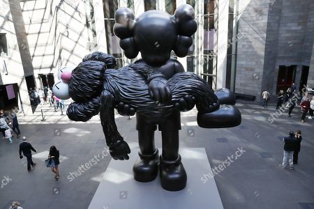 A seven-meter tall bronze sculpture entitled 'GONE' is displayed during the 'KAWS: Companionship in the Age of Loneliness' exhibition by American artist Brian Donnelly, also known as KAWS, at the National Gallery of Victoria in Melbourne, Australia, 19 September 2019.
