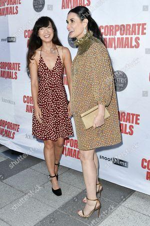 "Jennifer Kim, Demi Moore. Jennifer Kim, left, and Demi Moore attend the LA premiere of ""Corporate Animals"" at NeueHouse, in Los Angeles"