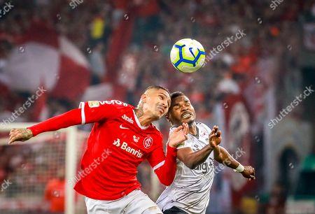 SC Internacional's forward Paolo Guerrero (L) in action against Atletico Paranaense's midfielder Nikao (R) during the Copa do Brazil final match against SC Internacional at the Beira-Rio Stadium in Porto Alegre, Brazil, 18 September 2019.