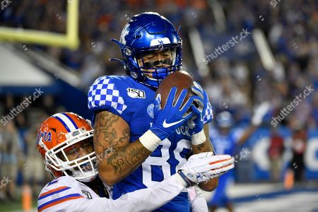 Kentucky tight end Keaton Upshaw (88) makes a catch over the defense of Florida defensive back Brad Stewart Jr. (2) for a touchdown during the second half of an NCAA college football game in Lexington, Ky., . Florida won 29-21