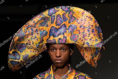 Model on the catwalk, hat detail