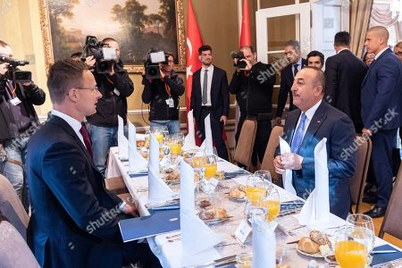 Hungarian Minister of Foreign Affairs and Trade Peter Szijjarto (L) and Turkish Minister of Foreign Affairs Mevlut Cavusoglu (R) attend a working breakfast in Budapest, Hungary, 19 September 2019. Cavusoglu arrived for the opening ceremony of the Budapest office of the Turkic Council. The council is an international organization comprising some of the Turkic-speaking countries, namely Azerbaijan, Kazakhstan, Kyrgyzstan, and Turkey. The organization was founded in 2009 and its General Secretariat operates in Istanbul.