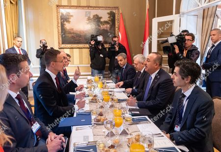 Hungarian Minister of Foreign Affairs and Trade Peter Szijjarto (2L) and Turkish Minister of Foreign Affairs Mevlut Cavusoglu (2R) attend a working breakfast in Budapest, Hungary, 19 September 2019. Cavusoglu arrived for the opening ceremony of the Budapest office of the Turkic Council. The council is an international organization comprising some of the Turkic-speaking countries, namely Azerbaijan, Kazakhstan, Kyrgyzstan, and Turkey. The organization was founded in 2009 and its General Secretariat operates in Istanbul.