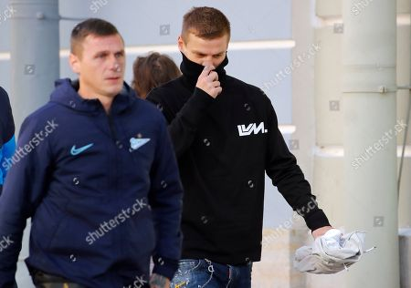 Stock Image of Zenit St. Petersburg soccer team striker Alexander Kokorin, right, walks to a medical center for a medical examination in St. Petersburg, Russia, . Two Russian national team soccer players, Zenit St. Petersburg forward Alexander Kokorin and FC Krasnodar midfielder Pavel Mamayev, were released from prison Tuesday after a court granted them parole, and Zenit chief executive said that the club has signed a contract with Kokorin through to the end of the season