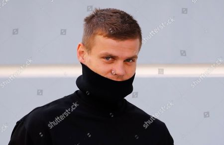 Zenit St. Petersburg soccer team striker Alexander Kokorin walks to a medical center for a medical examination in St. Petersburg, Russia, . Two Russian national team soccer players, Zenit St. Petersburg forward Alexander Kokorin and FC Krasnodar midfielder Pavel Mamayev, were released from prison Tuesday after a court granted them parole, and Zenit chief executive said that the club has signed a contract with Kokorin through to the end of the season