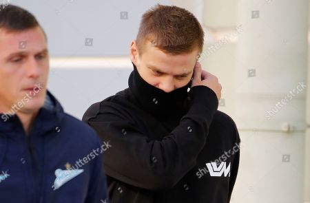 Zenit St. Petersburg soccer team striker Alexander Kokorin, right, walks to a medical center for a medical examination in St. Petersburg, Russia, . Two Russian national team soccer players, Zenit St. Petersburg forward Alexander Kokorin and FC Krasnodar midfielder Pavel Mamayev, were released from prison Tuesday after a court granted them parole, and Zenit chief executive said that the club has signed a contract with Kokorin through to the end of the season