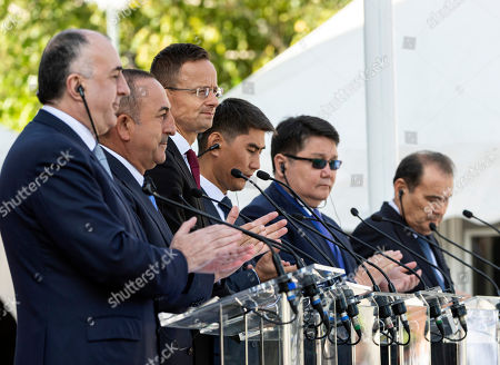 Stock Picture of Minister of Foreign Affairs of Azerbaijan Elmar Mammadyarov, Turkish Foreign Minister Mevlut Cavusoglu, Hungarian Minister of Foreign Affairs and Trade Peter Szijjarto, Minister of Foreign Affairs of Kyrgyzstan Chingiz Aidarbekov, Ambassador Extraordinary and Plenipotentiary of the Republic of Kazakhstan to Hungary Nurbakh Rustemov and Secretary General of the Turkic Council Baghdad Amreyev (L-R) hold a joint press conference during the opening ceremony of the Budapest office of the Turkic Council in Budapest, Hungary, 19 September 2019. The council is an international organization comprising some of the Turkic-speaking countries, namely Azerbaijan, Kazakhstan, Kyrgyzstan, and Turkey.