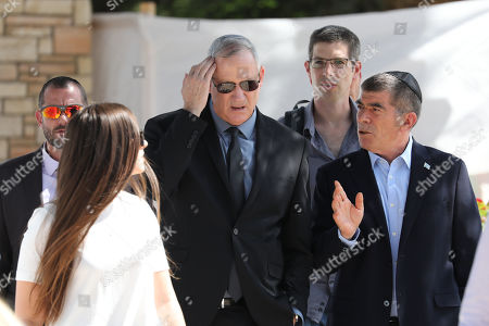 Benny Gantz (C), former Israeli Army Chief of Staff and chairman of the Blue and White Israeli centrist political alliance attends a memorial service for late Israeli president Shimon Peres at Mount Herzl, Israel's national cemetery, in Jerusalem, 19 September 2019.
