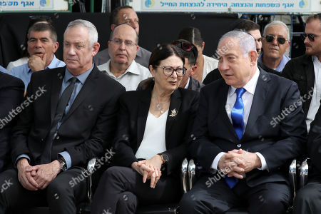 Israeli Prime Minister Benjamin Netanyahu (R) President of the Israeli Supreme Court Esther Hayut (C) and Benny Gantz (L), former Israeli Army Chief of Staff and chairman of the Blue and White Israeli centrist political alliance attend a memorial service for late Israeli president Shimon Peres at Mount Herzl, Israel's national cemetery, in Jerusalem, 19 September 2019.