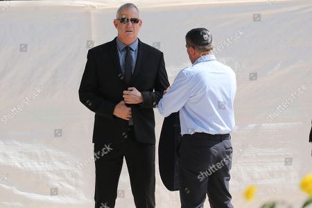 Benny Gantz (L), former Israeli Army Chief of Staff and chairman of the Blue and White Israeli centrist political alliance attends a memorial service for late Israeli president Shimon Peres at Mount Herzl, Israel's national cemetery, in Jerusalem, 19 September 2019.